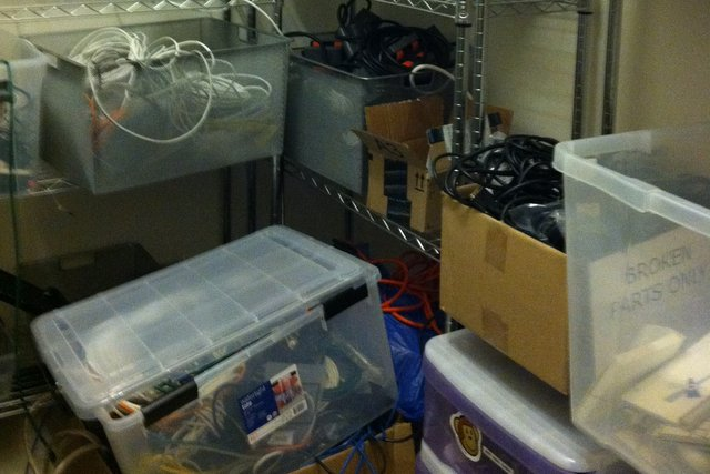 Before: cables stacked on the IT Supply Room floor.