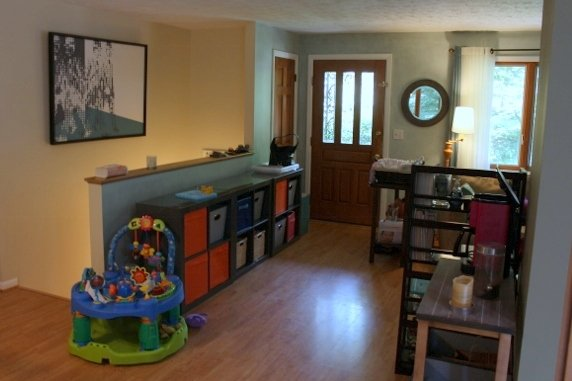 After: The entryway table with cubbies for each kid.