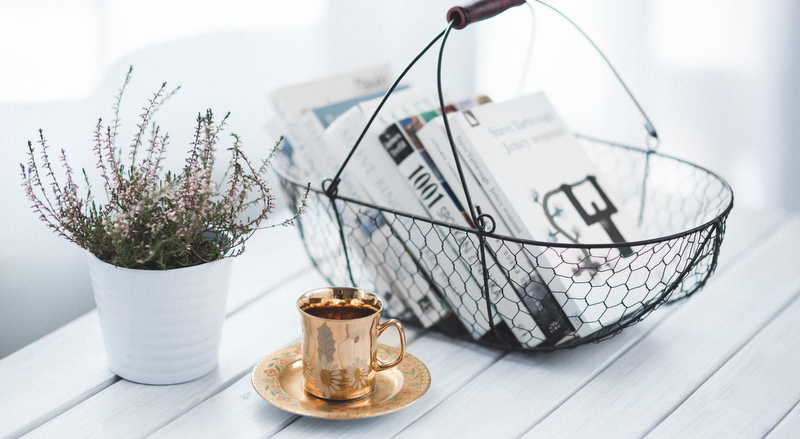 Ask Maeve_golden cup and basket with books